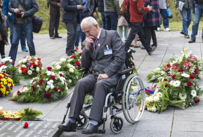 Former Nazi concentration camp survivor Marian Wach of Poland mourns between the flowers during the commemoration ceremonies for the 72th anniversary of the liberation of former Nazi concentration camp Mittelbau-Dora near Nordhausen, central Germany
