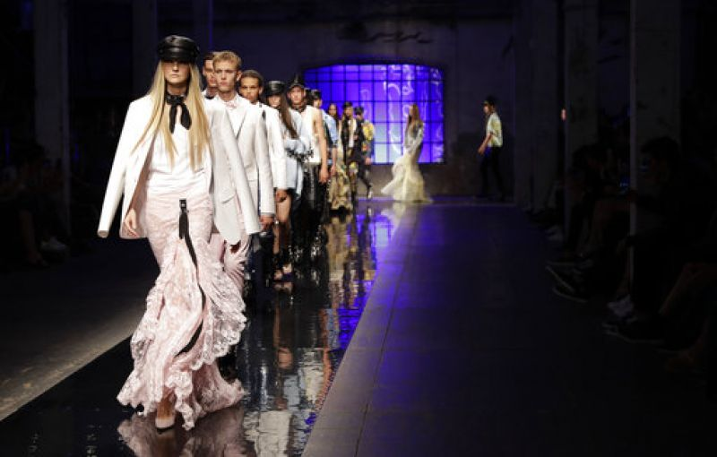 ModelS wear creations part of the DSquared2 men's Spring-Summer 2018 collection, presented in Milan, Italy, Sunday, June 18, 2017. (AP Photo/Antonio Calanni)