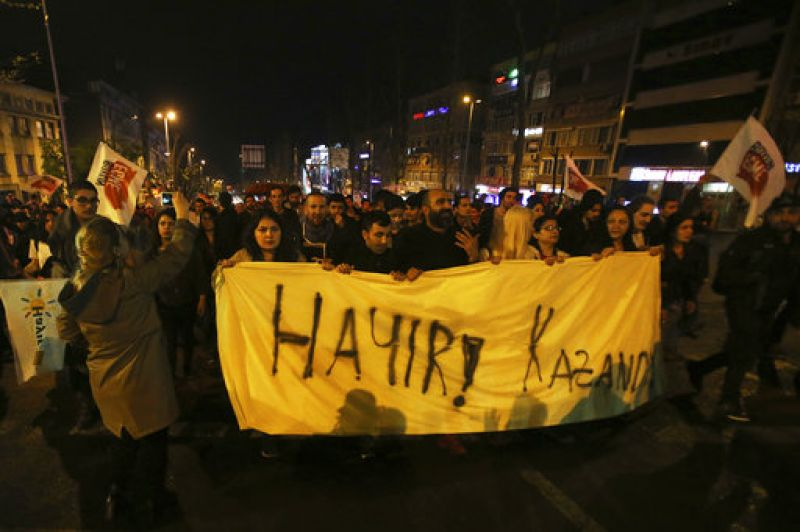 """In Besiktas, protesters held pamphlets with the words """"We are right, we will win"""". Others brandished viral hashtag slogans from the referendum night like """"The 'No' is not finished"""" and """"No has won""""."""