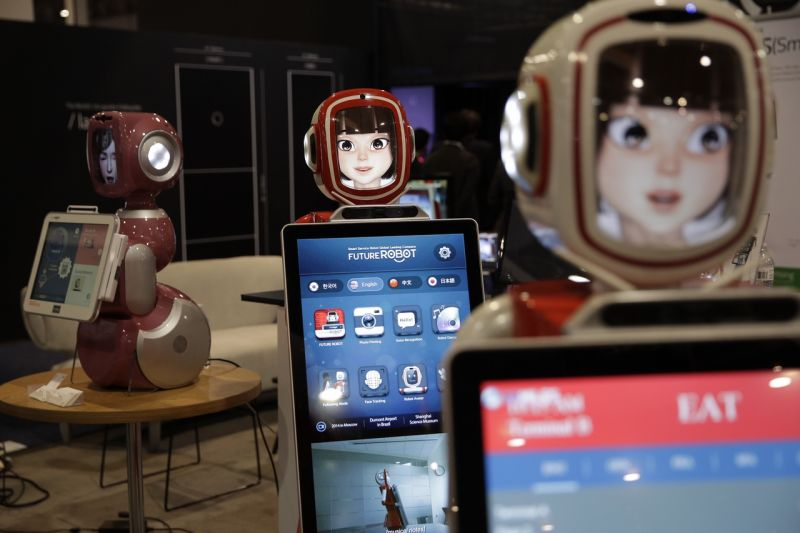 Furo smart service robots are demonstrated at CES International Friday, Jan. 6, 2017, in Las Vegas. (AP Photo/Jae C. Hong)