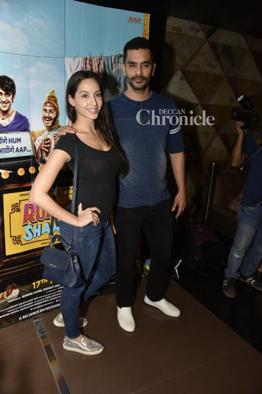 Nora Fatehi and Angad Bedi arrived together for the premiere.