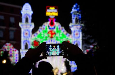 A man takes a photo during Fallas festival in Valencia as they celebrate the ancient