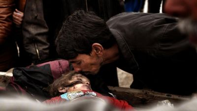 Relatives mourn over the body on an Iraqi child, killed in an airstrike targetting Islamic State (IS) group jihadists, West Mosul. According to a Unicef report, with at least 652 children killed in 2016 – a 20% increase on the year before – and 850 children recruited to fight in the conflict, nearly three times the 331 enlisted in 2015.