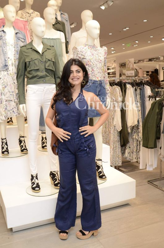 Shenaz Treasury poses for the cameras at a store event.