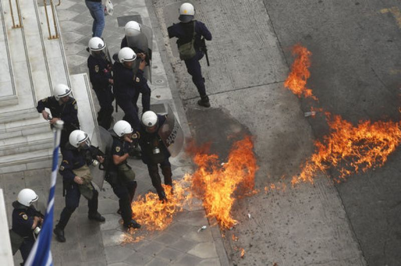 A small group of protesters threw gasoline bombs and fired flares at riot police after the marches ended in Athens.