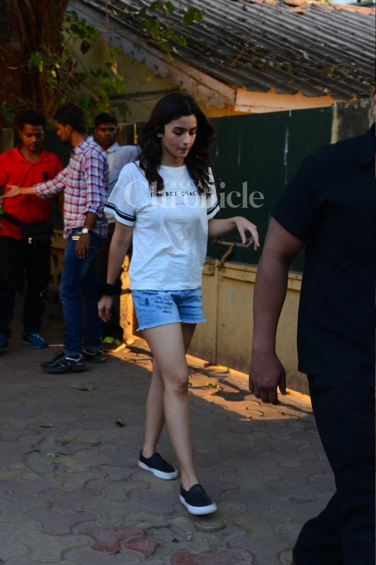 Alia Bhatt was spotted stepping out of a studio in Mumbai on Saturday. Dressed in a plain white t-shirt and blue shorts, Alia looked adorable.
