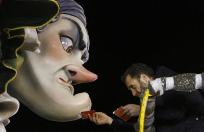 A worker makes final adjustments on a Falla before the start of the traditional Fallas festival in Valencia. (Photo: AP)