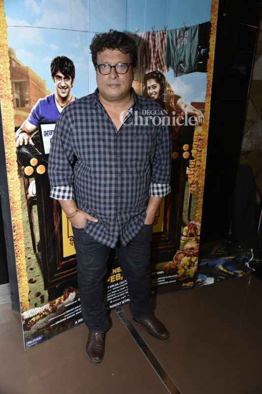 Tigmanshu Dhulia poses for the camera persons.