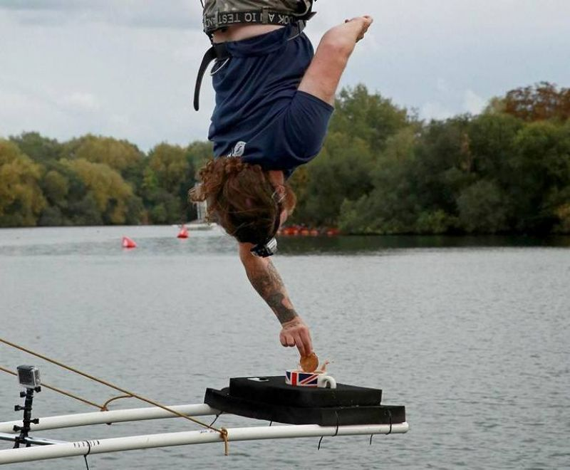 """In Britain, Simon Berry took the Guinness World Records title for """"highest bungee dunk"""" after dipping a biscuit into a cup of tea from his 73-metre (239.5 ft) bungee rope (Photo: Facebook)"""