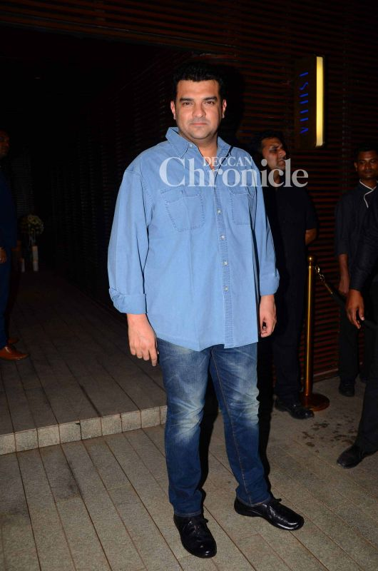 Siddharth Roy Kapur smiles for the cameras.