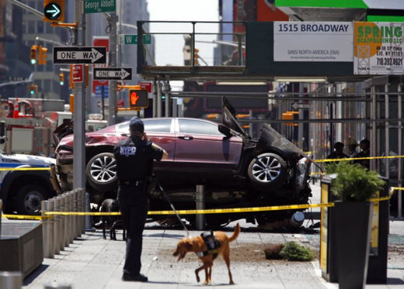 The vehicle leaned on a lamppost and steel barriers intended to block vehicles from getting onto the sidewalk.