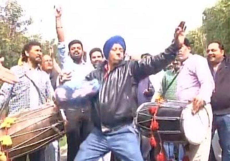 Celebrations outside Congress leader Navjot Singh Sidhu's residence in Amritsar.