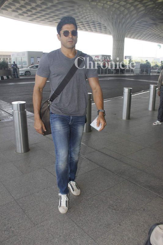 Farhan Akhtar was also seen arriving at the airport for his journey.