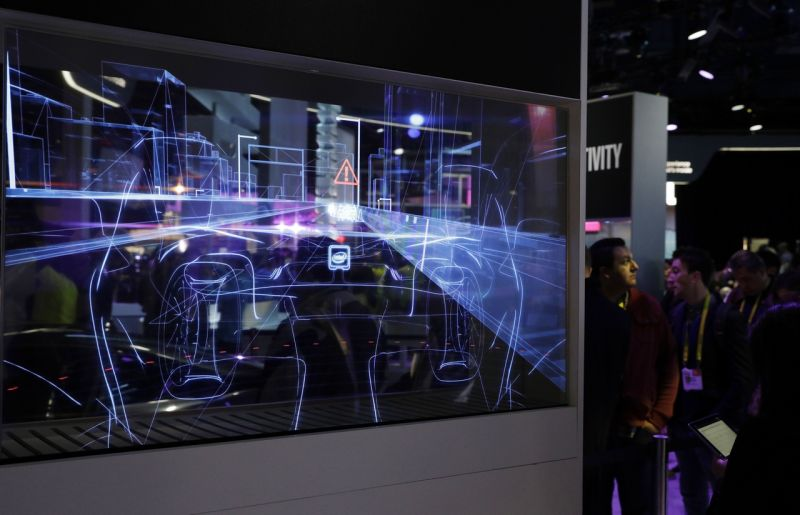 A translucent screen shows smart car technology at the Intel booth during CES International, Friday, Jan. 6, 2017, in Las Vegas. (AP Photo/John Locher)