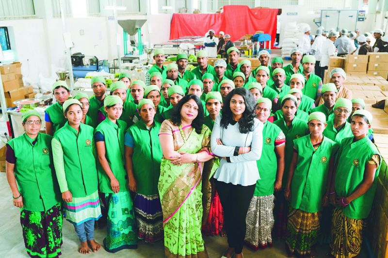 26-year-old Likitha Bhanu along with her mother Padmaja Bhanu strikes a pose with staff at the Terra Greens Organic Food Company established by the duo in Hyderabad in 2013. (Photo: DC)