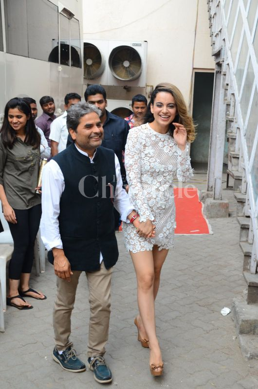 Kangana greeted her film's director with a warm hug and the two then walked in hand-in-hand.
