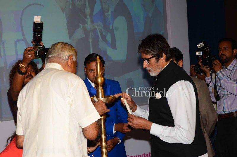 Bachchan lights the lamp at the event.