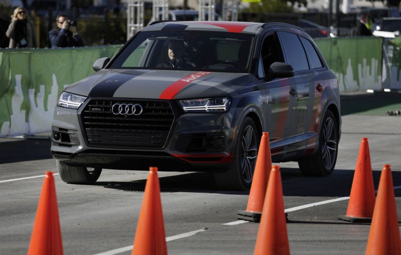 An autonomous car controlled by a Nvidia DRIVE PX 2 AI car computing platform drives passengers along a course during CES International, Friday, Jan. 6, 2017, in Las Vegas. (AP Photo/John Locher)
