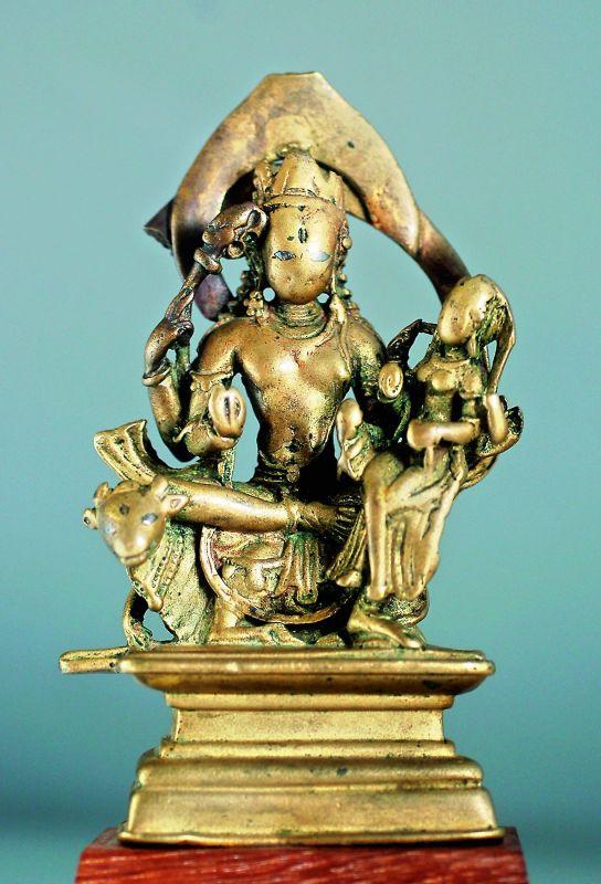 A brass statue of Lord Shiva seated with Goddess Uma (Uma-Maheshwara) from Chamba, Himachal Pradesh; dated 10th Century.