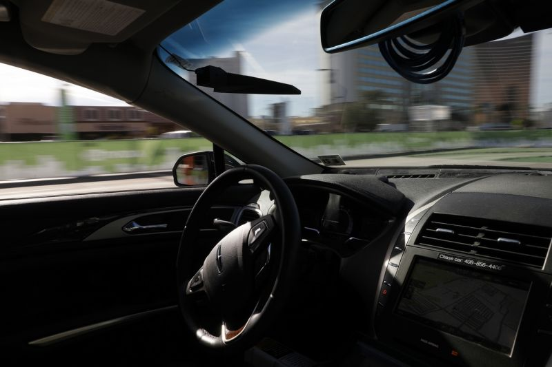 An autonomous car controlled by a Nvidia DRIVE PX 2 AI car computing platform drives along a course during CES International, Friday, Jan. 6, 2017, in Las Vegas. (AP Photo/John Locher)