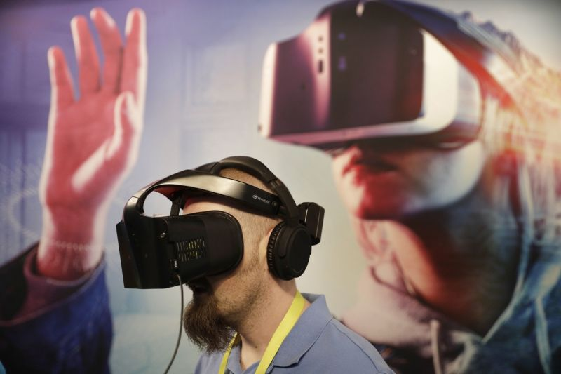 Brian St. George wears a Project Alloy VR headset at the Intel booth during CES International, Friday, Jan. 6, 2017, in Las Vegas. (AP Photo/John Locher)