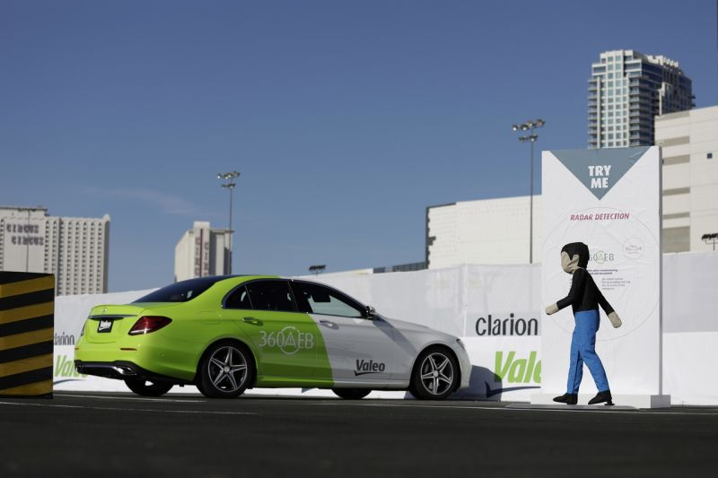 People ride in a car with a Valeo 360 automatic electronic braking system during CES International, Friday, Jan. 6, 2017, in Las Vegas. (AP Photo/John Locher)
