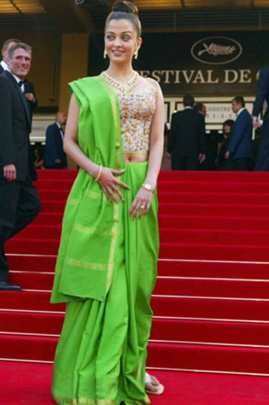 Cannes 2003: Aishwarya chose a neon green Neeta Lulla half-saree and her jewellery and top knot were panned by critics.