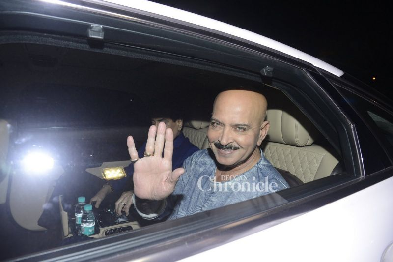 Rakesh Roshan acknowledges the cameras.