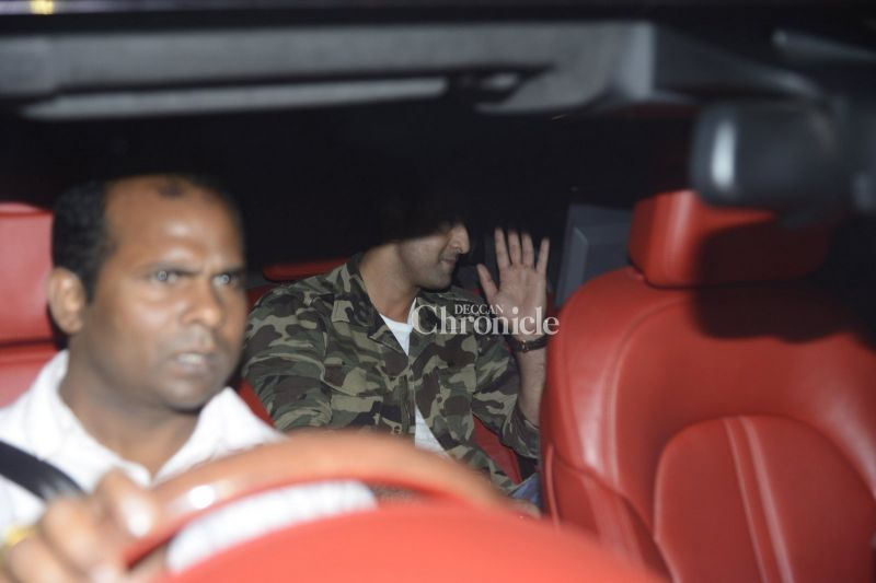 Ranbir Kapoor waves as he is snapped in his car while arriving.