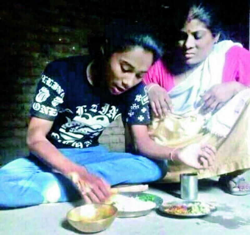 Hima Das with her mother Jonali at their home in Assam's Kandhulimari village.