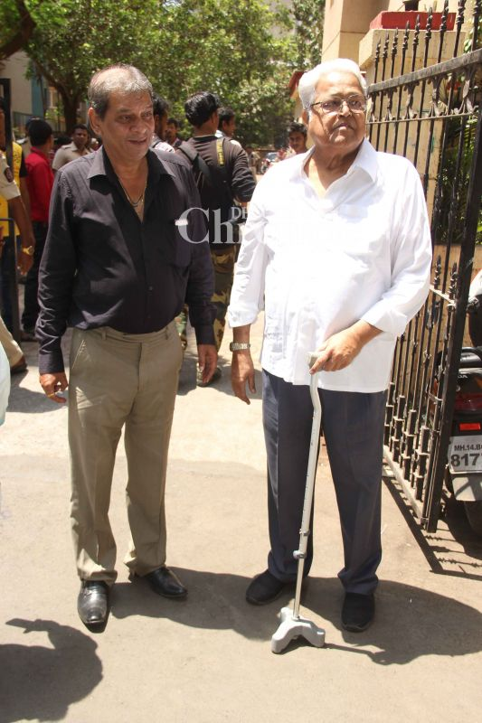Viju Khote (R) was also spotted by the cameras outside the crematorium.