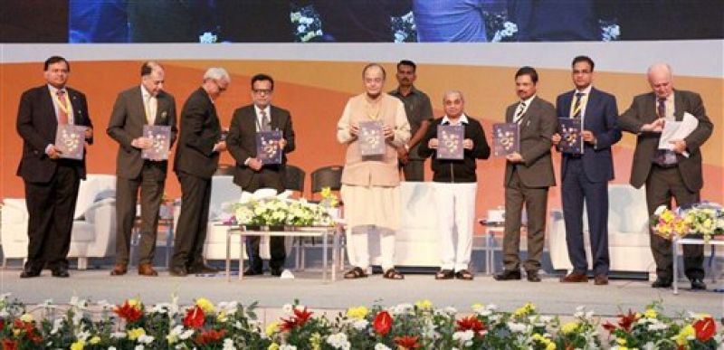 "Gandhinagar: Union Finance Minister Arun Jaitley releasing a book at the seminar on ""GST: The game changer for Indian Economy"" during the Vibrant Gujarat Global Summit 2017 at Mahatma Mandir in Gandhinagar, Gujarat on Wednesday. (Photo: PTI)"