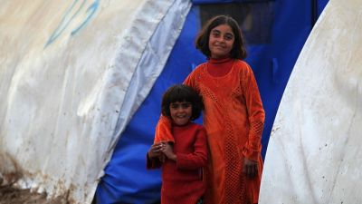"""12/12 Iraqis, displaced children from Mosul, smile as they are photographed at the Hammam al-Alil camp for the internally displaced. Unicef spokeswoman Juliette Touma warned the more than 2.3 million children forced out of school by the conflict will become a """"lost generation"""" unless they can resume their education."""