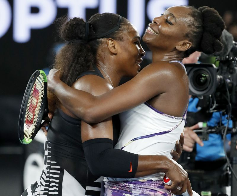 Serena Williams gets a hug from sister Venus after winning the final. (Photo: AP)