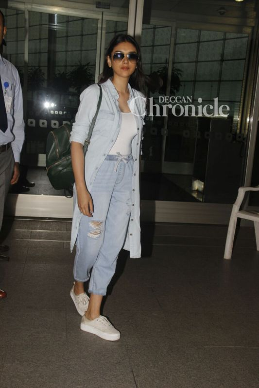 Aditi Rao Hydari poses for the cameras at the airport.