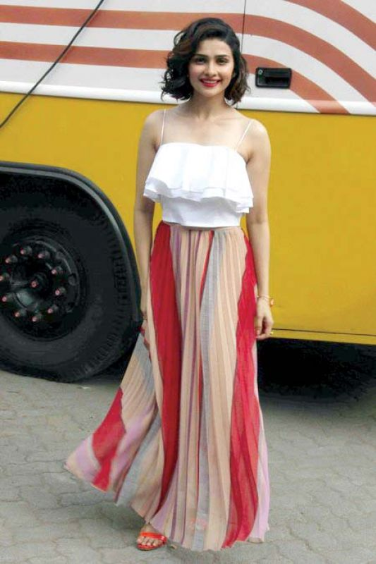 Actress Prachi Desai exudes the boho vibe in a ruffled boho blouse paired with a knife-pleated skirt.