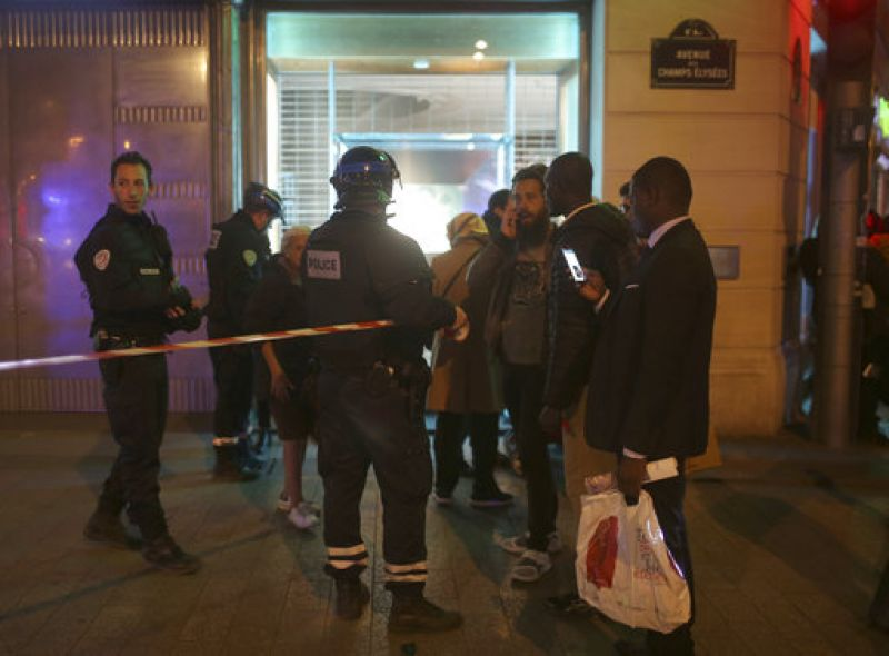 A witness identified only as Ines told French television station BFM that she heard a shooting and saw a man's body on the ground before police quickly evacuated the area where she works in a shop.