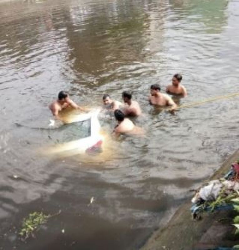 Vehicles fall into Kondli canal after landfill site collapses, many feared trapped