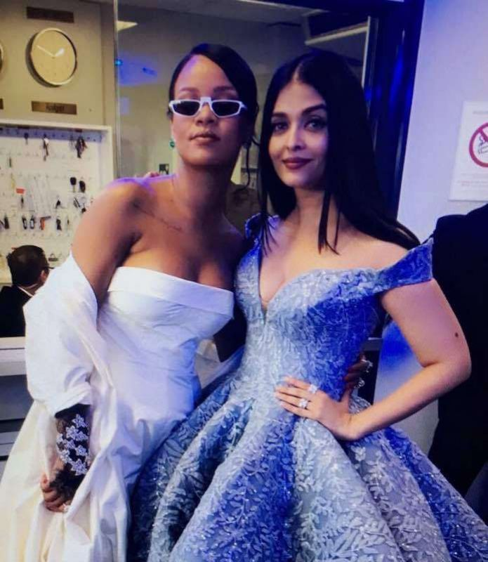 The actress even posed with international music star Rihanna after walking the red carpet .