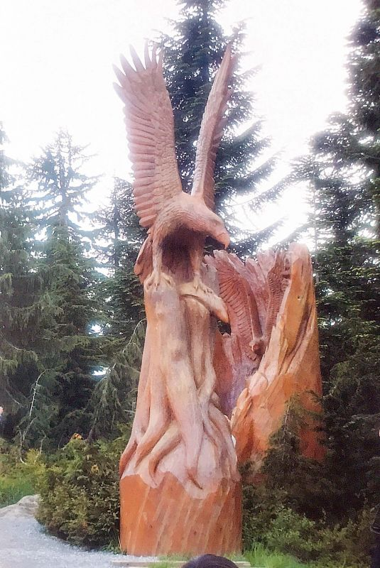 Squamish wood sculpture on a salvaged fallen tree.