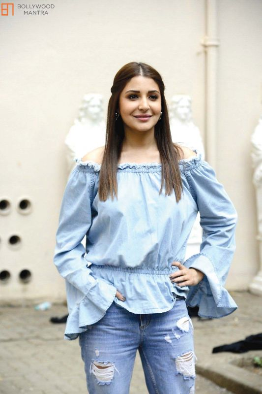Tip your toe in the trend ala Anushka Sharma and style your ruffled blouse with distressed denim.