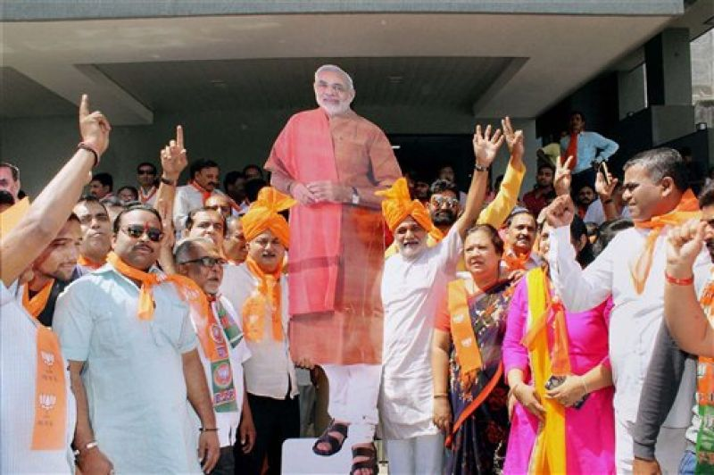 BJP supporters celebrating the party's victory in UP and Uttarakhand Assembly polls in Surat.