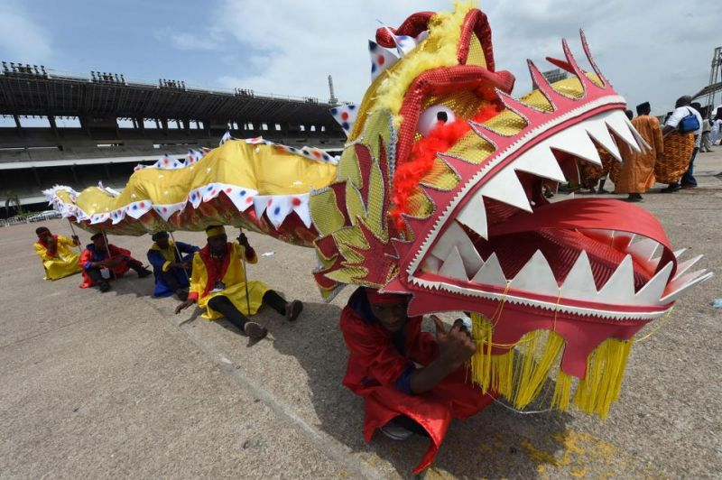 People perform with a Chinese dragon during a carnival in Lagos.