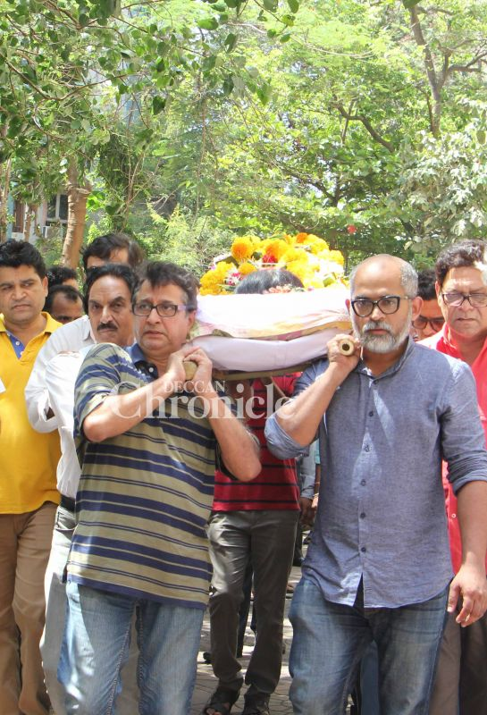 Her estranged husband Vivek Lagoo (L) was among the people who carried the body for the rites.