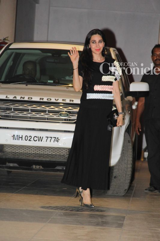 Karisma Kapoor acknowledges the cameras as she arrived for the bash.
