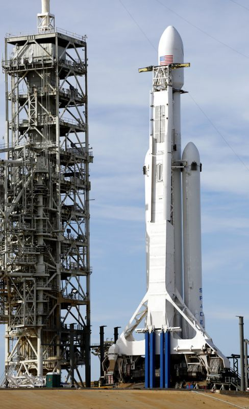 A Falcon 9 SpaceX heavy rocket stands ready for launch on pad 39A at the Kennedy Space Centre in Cape Canaveral, Fla.. The Falcon Heavy has three first-stage boosters, strapped together with 27 engines in all.