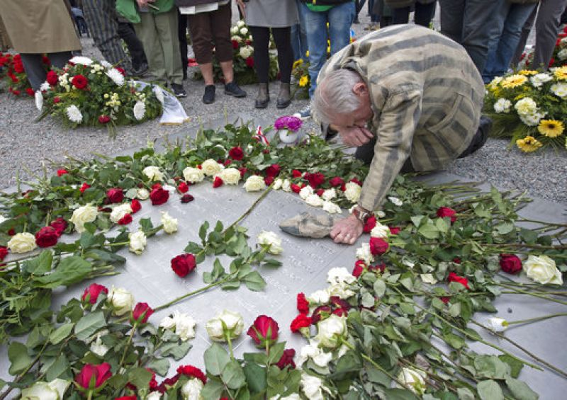 Nazi concentration camp survivor Alexander Bytschok of Kiev, Ukraine, mourns on a metal plaque during the commemoration ceremonies for the 72th anniversary of the liberation of the former Nazi concentration camp Buchenwald near Weimar, Germany