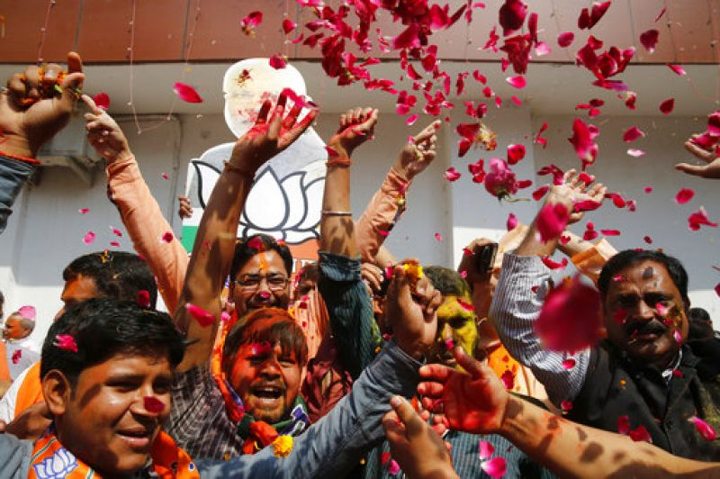 BJP supporters celebrate winning seats in the state legislature during elections in Lucknow.