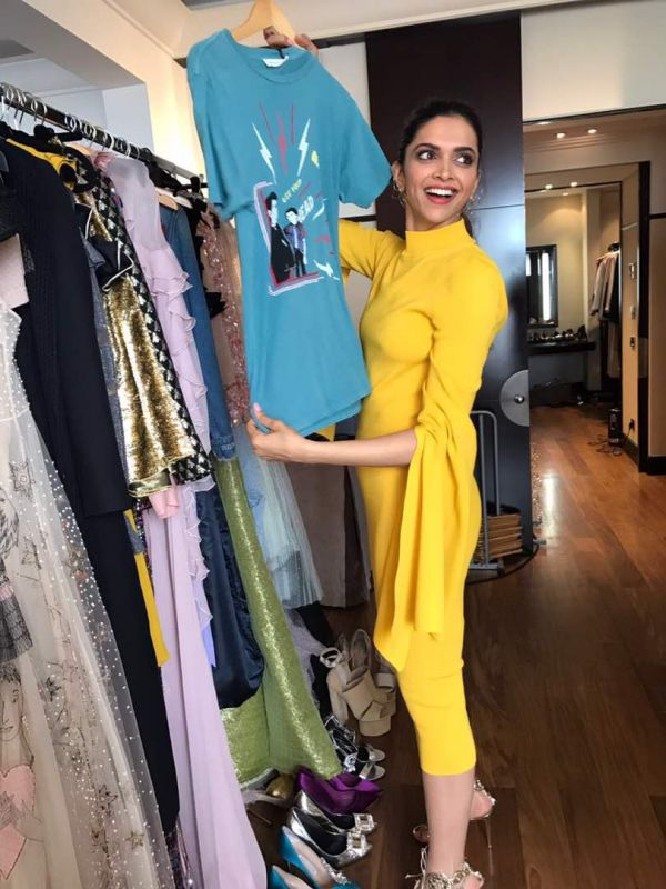 Deepika flashes her bright smile as she checks out a few outfits. .