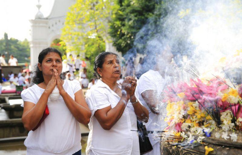 Sri Lankan Buddhist devotees offer prayers at a temple to mark Vesak full moon day or Buddha Purnima.